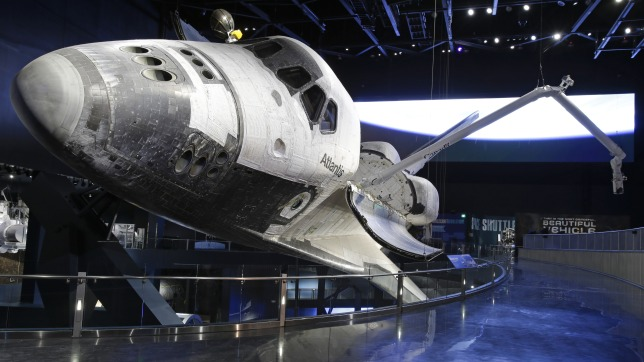 NASA; KENNEDY SPACE CENTER AND SPACE SHUTTLE ATLANTIS WELCOME YOU LITERALLY, WITH OPEN ARMS…….
