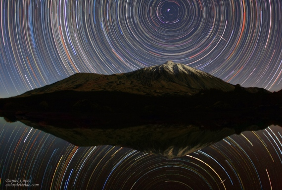 STARTRAILS AND SOME FLARE OVER TEIDE VOLCANO