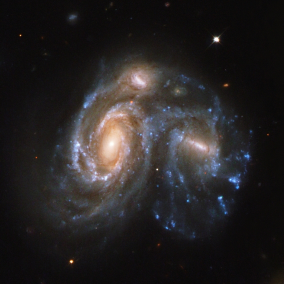 HUBBLE SPIES A GALACTIC TRAIN WRECK