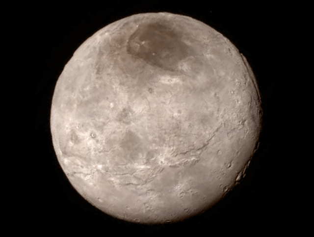Charon; Pluto's most prominent partner captured on July 13, 2015 by New Horizons from a distance of 289,000 mi (466,000 km).