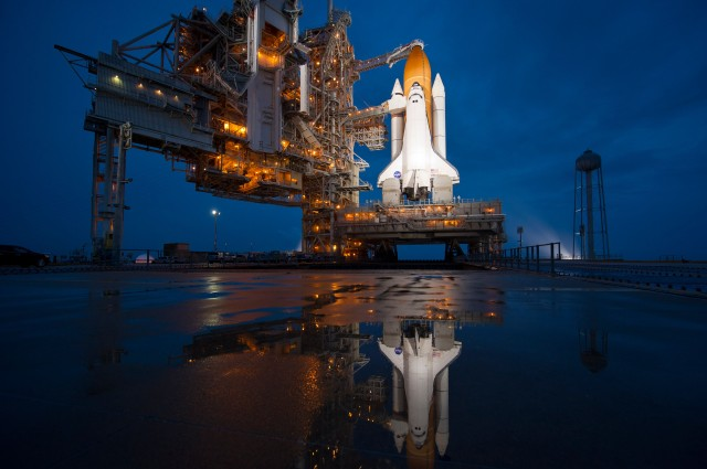 The space shuttle Atlantis is seen shortly after the rotating service structure (RSS) was rolled back at launch pad 39a, Thursday, July 7, 2011 at the NASA Kennedy Space Center in Cape Canaveral, Fla. Atlantis is set to liftoff Friday, July 8, on the final flight of the shuttle program, STS-135, a 12-day mission to the International Space Station. Photo Credit: (NASA/Bill Ingalls)